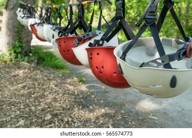 Row with red and white safety helmets / safety helmets / climbing equipment