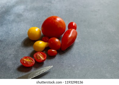 A row of red and yellow tomatoes