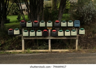 Row of residential collection of mailboxes in neighborhood in New Zealand.