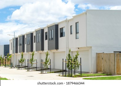 A row of residential townhomes or townhouses in Melbourne's suburb, VIC Australia. Concept of real estate development, the housing market, and homeownership.
