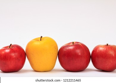 Row of ripe apples on a white background