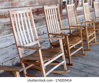 Row of Rocking Chairs on Porch
