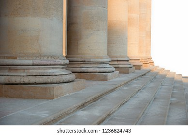 row of roman pillars in the evening sun and staircase, detail shot with selective focus