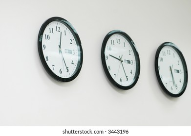 Row of round clocks on the wall