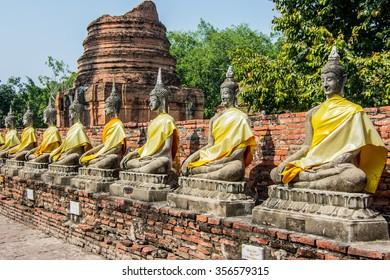 Row of ruined statue of buddha at Wat Yai Chaimongkol,Wat Yai Chai Mongkhon, Ayuthaya, Thailand,Asia