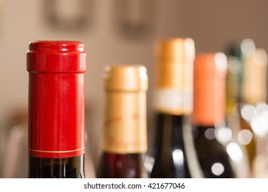 A row of sealed wine bottles