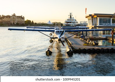 Row of Seaplanes Moored to a Jetty at Sunset. Victoria, BC, Canada.