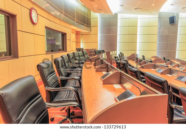 row of seat in empty conference room