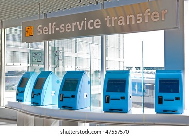 A row of self service check in machines in an airport