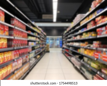 Row of shelf at hypermarket in blurred background