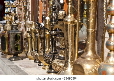 A row of shiny traditional coffee pots at the souq in Dubai.