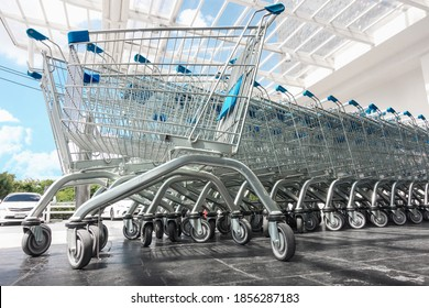 Row of Shopping Cart in Front of Supermarket Doorway for Customers Service, Empty Shopping Trolley in Front of Convenience Grocery Store. Business Commodity Retail and Customer Market Place