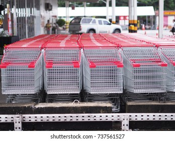 row of shopping carts red color at parking wet floor