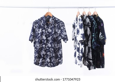 Row of short sleeved and T-shirt coconut ,tree, floral, leaves, tropical plant, fruit pattern on hanger