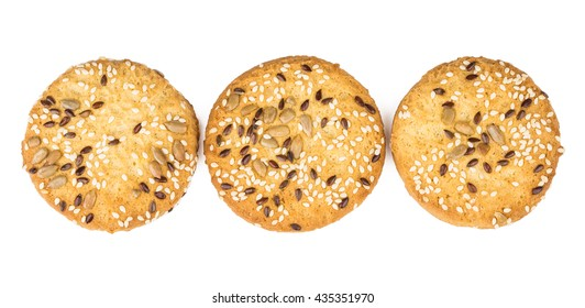 Row of shortbread cookies with sesame and sunflower seeds isolated on white background