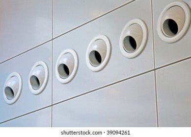 row of six air conditioning vents
