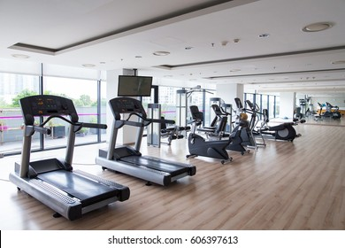 Row of sports equipment in fitness gym