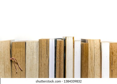 Row of stacked books on white background, education concept