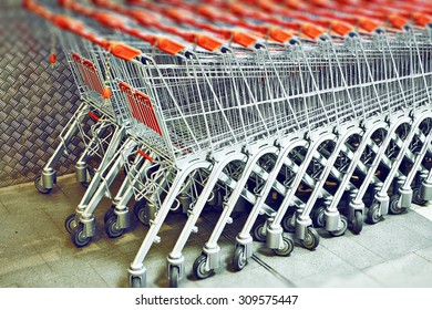 Row of Stacked Supermarket Trolleys
