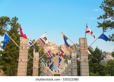Row of state flags leading to Mount Rushmore in Keystone, South Dakota