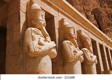 A row of staues of Queen Hatshepsut as Osiris, the god of the dead, at her temple in Luxor (Thebes)
