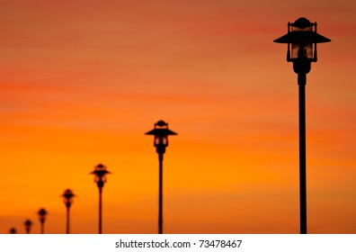 Row of street lamps aligned with beautiful sky in background