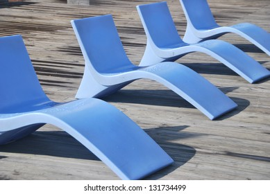 A row of stylish deck chairs