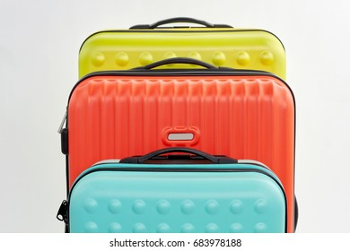 Row of suitcases, cropped image. Set of bags, white background.