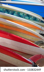 Row of Surfboards in the Sand