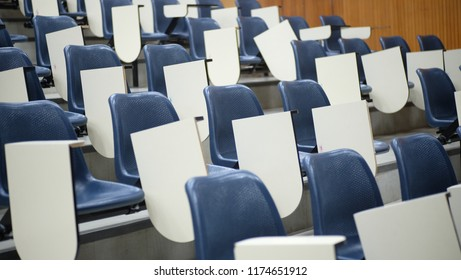 Row table-chairs in a slope room