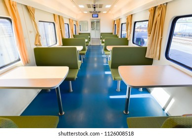 Row of tables and chairs for eating food in the train