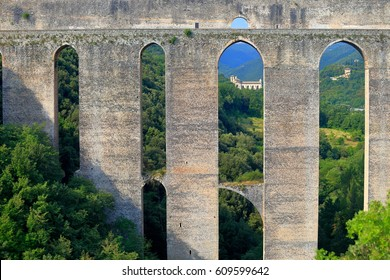 Row of tall arches of Ponte delle Torri in Spoleto, Umbria, Italy