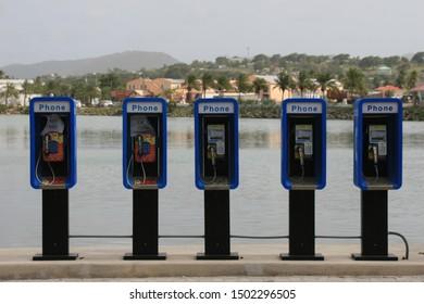 Row of telephone boxes, Antigua, Caribbean