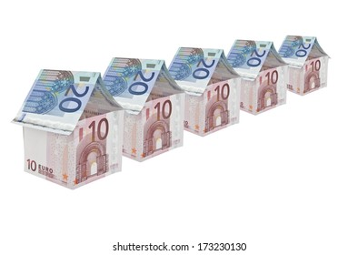 row of ten euro note houses with twenty euro note roof
