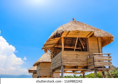 Row of Tiki Huts Sunny Beach Vacation Ocean Tropical Living