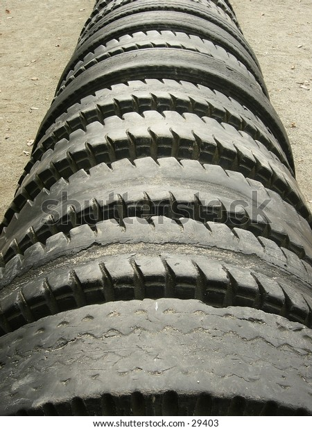 A row of tires set into the ground.