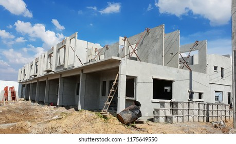 Row of Townhouse prefabricated building isolated on blue sky background.