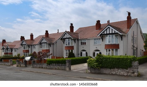 A row of traditional 1930s semi detached homes in a quiet residential area of Rhos on Sea , Conwy, North Wales UK