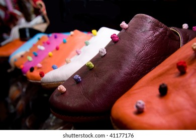row of traditional moroccan shoes, handmade babouches, in multicolored leather