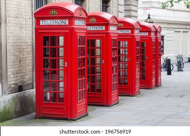 row of traditional phone boxes in London city