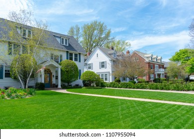 Row of traditional suburban homes and front lawns in nice neighborhood
