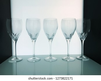 Row of transparent wine glass on showcase