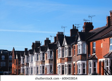 Row of Typical English Terrace Housing with a lovely blue sky sunny day background, Spring time of England United Kingdom.