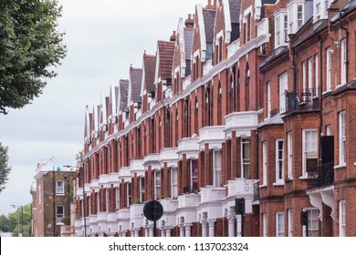 A row of typical London red brick terraced houses in Hammersmith area of west London