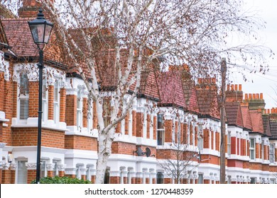 A row of typical red brick houses in suburban area of west London