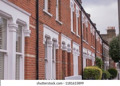A row of typical red brick terraced houses in London, UK