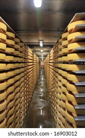 Row upon row of cheese stacked up in the cellar to mature.