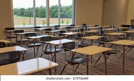 row of vacant school desks in high school classroom