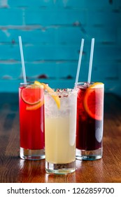 row of various colourfull alcoholic cocktails on bar counter in pup or restaurant copy space