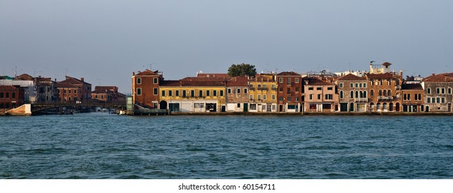 Row of a various houses on a bank